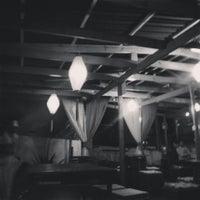 Photo taken at Dharma Lounge Bar by Sara V. on 6/14/2014