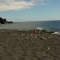 Photo taken at Playa de Charco Verde by Mirian A. on 5/28/2014