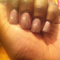 Photo taken at Pearl Nails Club Inc. by GiGi on 10/27/2012