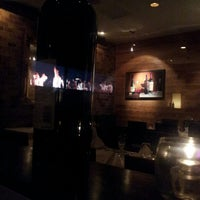 Photo taken at Vines Grille & Wine Bar by Ray D. on 6/22/2013