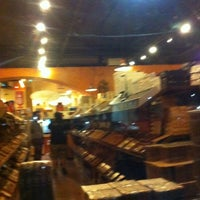 Photo taken at Corona Cigar Company & Drew Estate Lounge by M M. on 10/22/2012