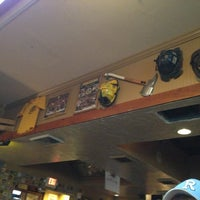 Photo taken at Calli Baker's Firehouse Bar & Grill by Kris K. on 7/23/2013