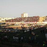 Photo taken at stade Demba Diop by Mouhamadou N. on 4/4/2014