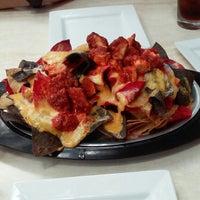 Photo taken at TreMonte Pizzeria Restaurant & Bar by Chanda E. on 7/7/2014