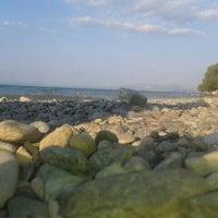 Photo taken at Vlastos beach by Sofia S. on 8/11/2015