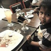 Photo taken at City Ice Cream Cafe by Eko P. on 5/10/2014