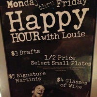 Photo taken at Bar Louie by Melissa Y. on 12/31/2012