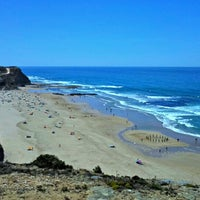 Foto tirada no(a) Praia da Amoreira por Adam M. em 8/7/2012