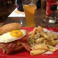 Photo taken at Red Robin Gourmet Burgers by Casey S. on 2/16/2013