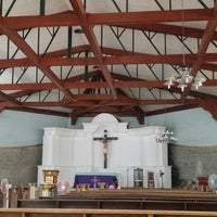 Photo taken at Holy Cross Parish by Nathaniel L. on 4/17/2014