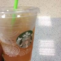 Photo taken at Starbucks by K F. on 6/30/2014