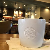 Photo taken at Starbucks by Kayoko H. on 12/30/2014