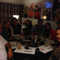 Photo taken at Ózzy Sushi Bar by Elaine C. on 5/18/2014