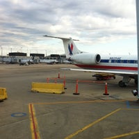 Photo taken at Gate G16 by Mark S. on 5/4/2014