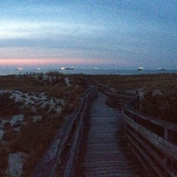 Photo taken at Cape Henry Inn Beach by Chad M. on 4/12/2014