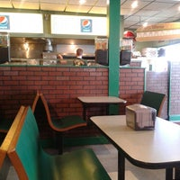 Photo taken at Gourmet Pizza by Marc R. on 9/6/2015
