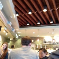 Photo taken at L'Artisan Cafe and Bakery by Spencer D. on 2/8/2013