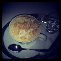 Photo taken at Dolce cafe by Erika M. on 5/10/2014