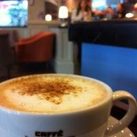 Photo taken at Caffè Nero by Pelin E. on 11/28/2012