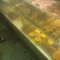 Photo taken at Dutch Girl Donuts by Gigi W. on 10/30/2012