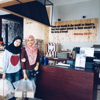 Photo taken at Moko Donuts and coffee by Amelia F. on 3/12/2015