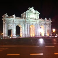 Photo taken at Alcalá Gate by Bryan P. on 10/7/2012