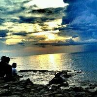 Photo taken at Pantai Senggigi by nikhen T. on 12/17/2012