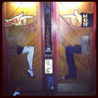 Photo taken at World Famous Dark Horse Bar & Grill by Cat L. on 2/15/2013