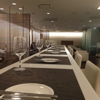 Photo taken at Oneworld Business Lounge by Neal R. on 11/29/2012