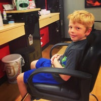 Photo taken at Sport Clips Haircuts of Camino Village Plaza by Ryan K. on 1/5/2013