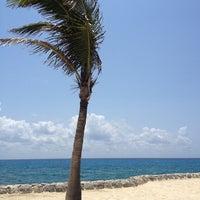 Photo taken at Playa Xcaret by Sharon K. on 4/21/2013