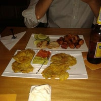 Photo taken at Potlatch Gourmet Laureles by Andres V. on 6/11/2014