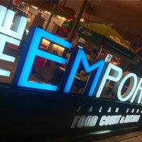 Photo taken at The Emporium Food Court & Bistro by Richard L. on 8/21/2012