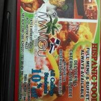 Photo taken at D'Mangu Restaurant by Cindy C. on 7/24/2012
