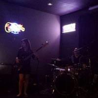 Photo taken at Sassy's Bar and Grille by Mojo H. on 4/19/2014