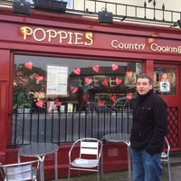 Photo taken at Poppies by Gilles B. on 2/9/2014