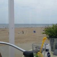Photo taken at Strandpaviljoen Willy Zuid by Martijn O. on 7/25/2014