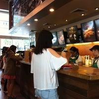 Photo taken at Starbucks Coffee by Irvin K. on 7/26/2013