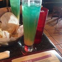 Photo taken at Mexi-Go Restaurant by Carolina V. on 5/2/2014