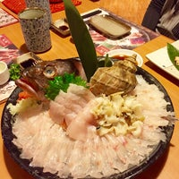 Photo taken at Naruto Uo Ichiba Izakaya 鳴門魚市場居酒屋 by Irene W. on 3/19/2015