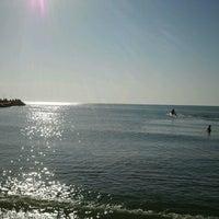 Photo taken at Plaja Neptun by Lex d. on 7/23/2013