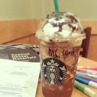 Photo taken at Starbucks by Wen T. on 12/13/2012