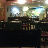 Photo taken at Ozone Café by Ken C. on 12/31/2013