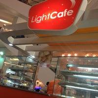 Photo taken at LightCafé by Victor V. on 3/25/2013