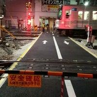 Photo taken at 東武伊勢崎線第38号踏切(竹ノ塚駅北側踏切) by Clara . on 2/27/2017