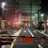 Photo taken at 東武伊勢崎線第38号踏切(竹ノ塚駅北側踏切) by Clara . on 3/3/2017
