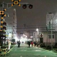 Photo taken at 東武伊勢崎線第38号踏切(竹ノ塚駅北側踏切) by Clara . on 12/13/2016