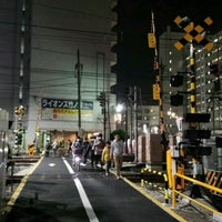 Photo taken at 東武伊勢崎線第38号踏切(竹ノ塚駅北側踏切) by Clara . on 12/21/2016