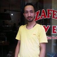 Photo taken at Zafer Çay Evi İbocuğun Yeri by Hakan Ö. on 5/29/2014