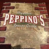 Photo taken at Peppino's Pizzeria Ristorante by Ari B. on 12/23/2012